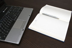 Computer and paper notebooks Royalty Free Stock Image