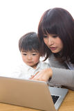 Computer and parent and child. Parent and child who watch a computer Stock Photo