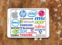 Computer (PC) brands and logos. Collection of logos and brands of most popular computer and hardware companies on white tablet on wooden background Stock Images
