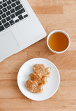 Computer pc with japanese snack and tea Royalty Free Stock Photography