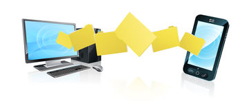 Computer phone file transfer. Concept of files or folders moving between a desktop computer and mobile phone Royalty Free Stock Image