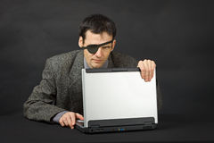 Computer pirate look with one eye Royalty Free Stock Photo