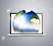 Computer and planet earth Royalty Free Stock Photos