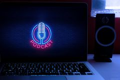 Computer  with the PODCAST logo