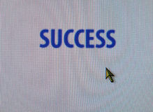 Computer pointer and success Stock Photos