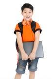 Computer portatile asiatico felice della tenuta del ragazzo Fotografia Stock