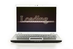 Computer portatile/computer portatile con il messaggio di caricamento fotografia stock libera da diritti