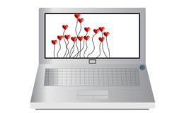Computer portatile con i palloni del cuore Fotografia Stock