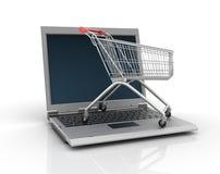 Computer portatile con il carrello di acquisto Fotografia Stock
