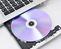 Computer portatile con il disco in bianco Fotografia Stock