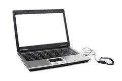 Computer portatile con il mouse Fotografia Stock Libera da Diritti