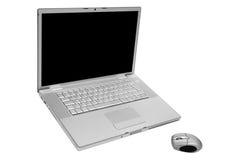 Computer portatile con il mouse senza fili Immagini Stock