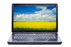 Computer portatile con il paesaggio Fotografia Stock