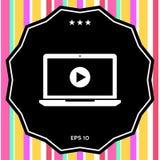 Computer portatile con l'icona del tasto di riproduzione Fotografie Stock