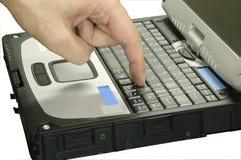 computer portatile con la mano 2 isolata fotografia stock