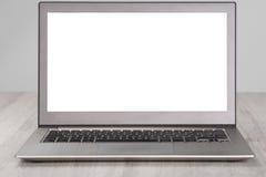 Computer portatile con lo schermo bianco in bianco Fotografie Stock