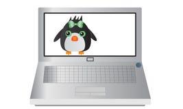 Computer portatile con un pinguino Immagine Stock