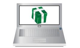 Computer portatile con un presente Fotografie Stock