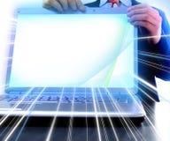 Computer portatile con uno schermo in bianco Fotografia Stock Libera da Diritti