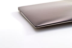 Computer portatile d'argento su bianco Fotografia Stock