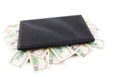 Computer portatile del calcolatore e dollari US Fotografia Stock Libera da Diritti