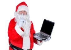 Computer portatile della holding del Babbo Natale Fotografia Stock Libera da Diritti