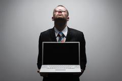 Computer portatile della holding dell'uomo di affari Fotografia Stock Libera da Diritti