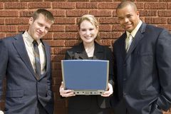Computer portatile della squadra di affari Immagini Stock Libere da Diritti