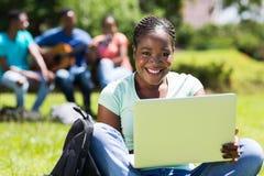 Computer portatile dello studente Immagini Stock