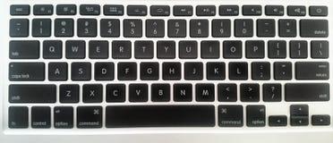 Computer portatile di bianco del nero del mackintosh della tastiera Fotografie Stock