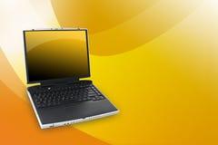 Computer portatile di colore giallo arancione Fotografia Stock Libera da Diritti