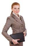 Computer portatile di trasporto della donna di affari. Fotografia Stock