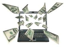 Computer portatile e dollari Fotografie Stock