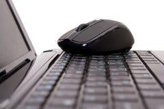 Computer portatile e mouse Immagini Stock Libere da Diritti