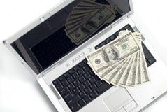 Computer portatile e soldi Fotografia Stock