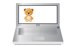 Computer portatile e Teddy Bear Fotografie Stock