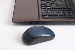 Computer portatile e topo Immagini Stock