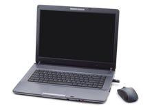 Computer portatile ed il suo mouse Fotografia Stock Libera da Diritti