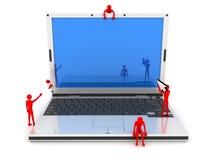 Computer portatile ed uomini Fotografia Stock