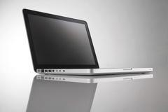 Computer portatile grigio Immagini Stock Libere da Diritti