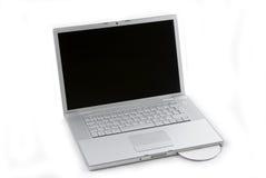 Computer portatile isolato con CD Immagini Stock Libere da Diritti