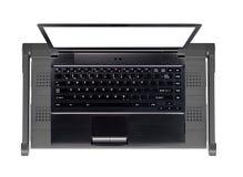 Computer portatile moderno ed alla moda sul supporto fotografia stock
