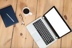 Computer portatile sul pavimento di legno Fotografia Stock