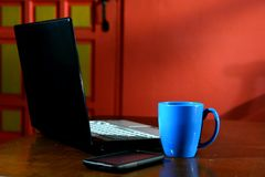 Computer portatile, tazza da caffè e Smartphone Fotografia Stock