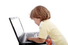 Computer portatili del bambino fotografia stock