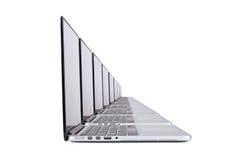 Computer portatili nella fila Fotografia Stock Libera da Diritti