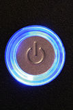 Computer power button. Blue glowing power button - computer or any device is on royalty free stock photos