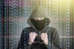 Hackers programmer look on screen and forcibly writes the program code hack information royalty free stock images