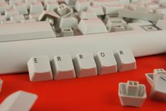 Computer problem. White broken keyboard and wodr error made of keyboard keys Stock Photos