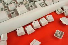 Computer problem. White broken keyboard and word virus made of keyboard keys Royalty Free Stock Photo